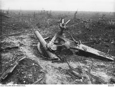 The remains of a German 5.9 inch howitzer in the Copse at Pozieres, in France, in October 1916. This position was taken by the 3rd and 11th Battalions in the fighting three months previously.