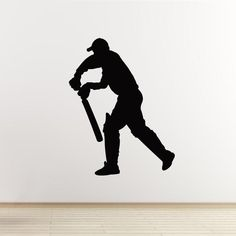 Our 'Batsman Standing' cricket wall sticker shows the silhouette of a cricketer in action. A great decal for any boy's sports themed bedroom or playroom.