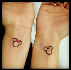 This tattoo is too cute I want mine on my ankles though Mickey and minnie mouse tattoo Too cute!! Will kill to have done://