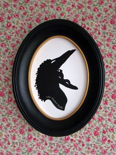 This is a hand-cut paper silhouette of Barbara Maitland. It comes mounted on a 5x7 piece of sturdy white cardstock, ready to frame. These