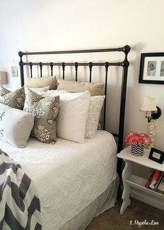 It's time to update your guest room for summer visitors!  Start with a cozy bed, layered with lots of pillows.  I buy soft feather down pillows and high thread count sheets at HomeGoods, and then add accessories and a throw blanket to be sure that no one freezes at night.  I also frame the wireless password and put it in the guest room so no one has to ask.  There are lots of other great tips for hosts or hostesses in this post--so enjoy your visitors!  {Sponsored by HomeGoods}