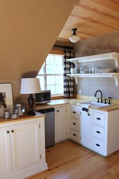 Cute little dormer kitchenette. Perfect for a garage apartment or a tiny home.