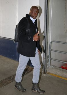 Thumbs up for Broncos defensive end DeMarcus Ware's off-the-field style.