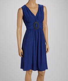 A+sensual+dress+provides+comfort+and+style+for+simple-chic+occasions.+Stretch-blend+fabric+provides+a+comfortable+fit,+while+a+signature+buckle+adorning+the+bodice+gently+nips+in+the+waist+creating+a+figure+flattering+hourglass+silhouette.