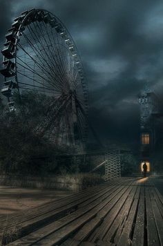 Abandoned amusement park.   The mood created in this image is very dark, the use of perspective creating the idea that something is 'looming' in the same way the decayed Ferris Wheel is.