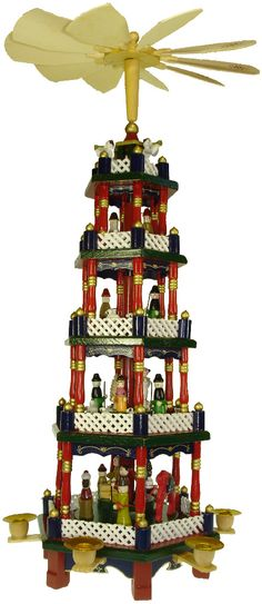 German Christmas pyramids-My Grandma had something very similar to this when I was growing up. German Christmas Decorations, German Christmas Traditions, German Christmas Pyramid, German Christmas Markets, Christmas Store, All Things Christmas, Christmas Holidays, Christmas Crafts, Christmas Ornaments