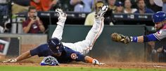 Houston Astros pinch runner Carlos Gomez, left, beats the tag of Texas Rangers…