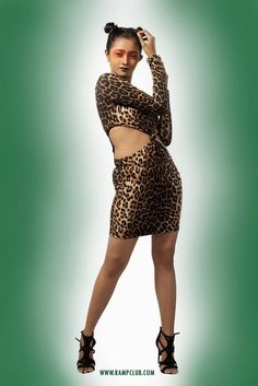 Ramp Club portraits #Women as a Tigress.  Style: Cold Belly Skin Tight #Dress House: Modd - Jakarta, Indonesia Fabric: Rubber Stretched #Fabric Size: Free Color: Tiger Print Price: Rs.2000 Purchase Mode: Book through FB Inbox / WhatsApp / Ramp Club Store for more Designs. www.rampclub.com