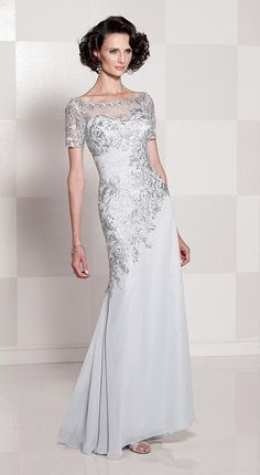 Chiffon modified mermaid evening dress with sheer lace short sleeves, bateau neck sheer lace over a sweetheart bodice featuring hand-beaded lace and ruched chiffon midriff, asymmetrically dropped waistline, sheer lace overlay back bodice, sweep train.