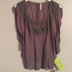 Embellished flow-y top Brand new- with tags. Comes with extra beading. Mint condition Urban Outfitters Tops Blouses