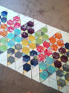Simply Triangles by Fresh Lemons Quilts : Faith.  More fine inspiration, 60 degree pieced triangles as a band across white space. yes.