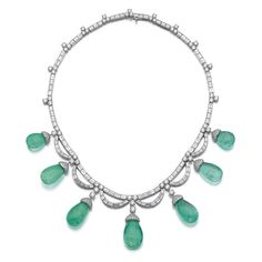 Emerald and diamond Necklace, Bulgari Designed as a line of brilliant-cut and baguette diamonds, supporting drop shaped emeralds capped with brilliant-cut diamonds, length approximately 420mm, signed Bulgari, pouch stamped Bulgari.