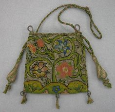 "Purse or bag, canvaswork embroidery 1600-1625 Origin: England W: 4""; L: 3 5/8"" Silk, silver metallic threads, linen ground, wood tassel forms Acc. No. 1956-554 http://emuseum.history.org/view/objects/asitem/2536/74/title-asc?t:state:flow=ba3d8717-f6db-46f4-a531-2b257819c3b7"