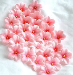 Gumpaste Edilbe Cake Decorations Light Pink Gum Paste Blossoms 25 piece. $12.50, via Etsy.