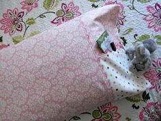 Pocket Pillowcase Pattern & Tutorial from Just Another Hang Up. Great place to stick books or stuffed animal....I think iPod or itouch as well.
