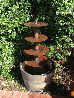 Discs from an old farm implement repurposed into a rustic for Old tin baths for sale