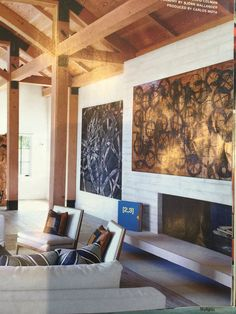 Use of oversized paintings for sunken living room and entry