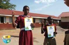 New WASH United club members with their certificates doing the WASH United pledge. (Uganda)