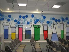 Painted large flasks & taped balloons to make it look like bubbles!