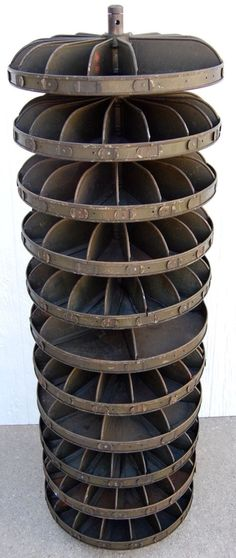 Antique steel round rotating industrial parts bin.