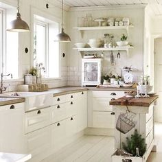 Implied: I love how bright and airy this kitchen looks. The cream colored EVERYTHING make it seem like it's just super well-lit everywhere.