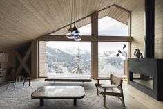 Image 67 of 90 from gallery of Mountain House / Studio Razavi architecture. Photograph by Simone Bossi Scandinavian Architecture, Contemporary Architecture, Queen Bunk Beds, Mountain Cottage, Iron Wall, Home Studio, Exterior Lighting, Rental Property, Living Room Kitchen