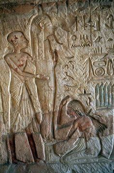 Painted relief with slave on knees inside Tomb of Horemheb ,Necropolis of Saqqara
