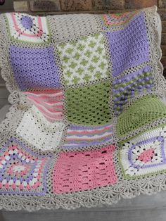 Afghan from this pattern: http://www.redheart.com/free-patterns/crochet-sampler-afghan