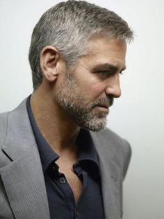 George Clooney might be more handsome than you, but that doesn't mean you can't be as stylish as him. Here's a quick guide to George Clooney style. Gorgeous Men, Beautiful People, Salt And Pepper Hair, Grey Beards, Silver Foxes, Hommes Sexy, Going Gray, Grey Hair, Lilac Hair