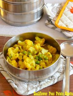 Cauliflower-Peas side dish  Recipe blogged : http://saffrontrail.blogspot.in/2012/03/ammas-cauliflower-peas-koottu.html