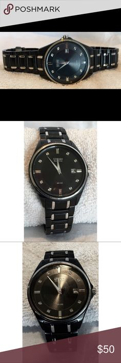 Citizen Eco-Drive WR100 Black Watch Preowned.  Citizen Eco-Drive WR100 Black Dial Stainless Steel with Diamond like accents.  Watch is running and appears to be keeping time with no obvious issues.  The watch shows signs of wear, with scratches as shown in pictures 2 and 3. Citizen Accessories Watches