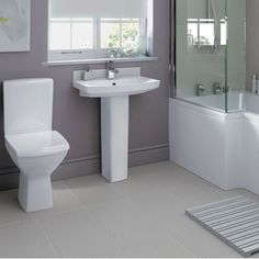 Navassa toilet and basin. A fantastic new contemporary bathroom suite. Works perfectly with outer Emberton L shaped Shower Bath - perfect for rooms that aren't big enough for a shower enclosure and a bath Homebase Bathrooms, Simple Bathroom Designs, Bathroom Photos, Bathroom Ideas, Shower Enclosure, Amazing Bathrooms, Decoration, Contemporary Design, Ideal Home