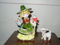 For sale at Retrophoria.com, $12.00 - Cute chained figurine.