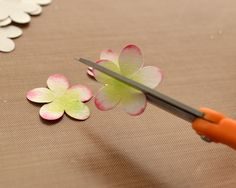 Crafting Life's Pieces: Baby Card and Lotus Flower Tutorial | Cut a little slit between the petals toward the center of the flower. - See more at: http://craftinglifespieces.blogspot.com/2013/12/baby-card-and-lotus-flower-tutorial.html