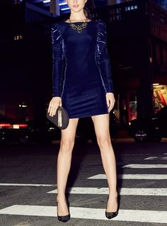 The perfect outfit for a night out on the town. This navy body-con dress pops with its gorgeous shoulder detail.