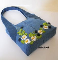 This Embroidered denim bag Jeans bag with ribbons embroidered Recycled fabric sac Summer floral purse Shoulder bagful Eco friendly tote bag is just one of the custom, handmade pieces you'll find in our shoulder bags shops. Denim women's shoulder bag with Denim Handbags, Denim Tote Bags, Denim Purse, Denim Jeans, Denim Skirt, Handmade Handbags, Handmade Bags, Embroidery Bags, Etsy Embroidery