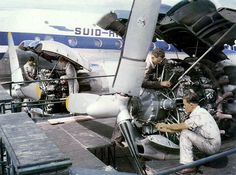 SAA mechanics servicing a Lockheed Constellation's engines at Jan Smuts Airport Aviation Mechanic, Airplane Photography, Passenger Aircraft, Aircraft Engine, Commercial Aircraft, African History, Constellations, Fighter Jets, Monster Trucks