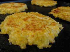 """Cheesy Cauliflower Patties  1 head cauliflower 2 large eggs 1/2 c cheddar, grated 1/2 c panko 1/2 t cayenne pepper  salt olive oil  Cut cauliflower into florets & cook in boiling water until tender. Drain. Mash the cauliflower while still warm. Stir cheese, eggs, panko, cayenne & salt to taste. Coat a griddle or skillet with olive oil, medium-high heat. Form the mixture into patties 3"""" across. Cook until golden brown & set, about 3 minutes per side. Keep warm in oven."""