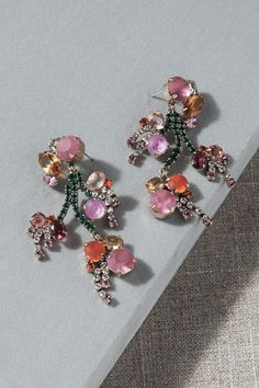 A vibrant cluster of crystals forms these eye-catching chandelier earrings, sure to add a pop of color to any look.
