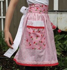"Aprons by Lori Holt... made from her fabric line ""Sew Cherry""."