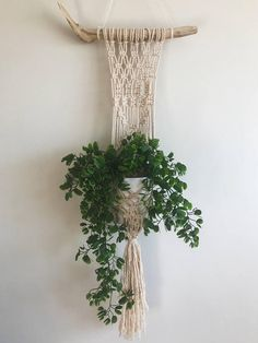 Add some beautiful greenery to any space with this macrame plant hanger. Size is completely customizable so please message me if you have something else in mind. This price shown is for the size pictured : 12 inches wide//28 inches long. MADE TO ORDER Each wall hanging is made to