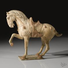 http://www.chinapotteryonline.com/wp-content/uploads/2010/10/A-PAINTED-POTTERY-FIGURE-OF-A-PRANCING-HORSE1.jpg