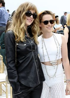 Dakota&kristen posing together at the chanel fashion show july 8th 2014
