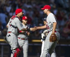 Adam Wainwright and Yadier Molina shake hands after Wainwright pitches a complete game against the Milwaukee Brewers. Cards won 9-1.  9-07-14