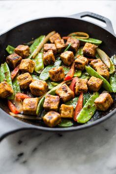 Jamaican Jerk Tofu Stir Fry - easy vegan meal that is full of spice! by Lisa Lin of healthynibblesandbits.com