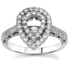 This elegant pear shape engagement ring setting is crafted in lustrous 14K White Gold. The alluring center piece is prong set with small round cut diamonds. This is an ideal diamond engagement ring setting for a pear shape diamond.