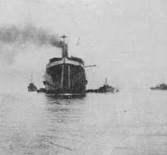 25 April, 1915, SS River Clyde about five minutes before beaching herself. 'Destroyers standing by for first sweep – transports coming up.'