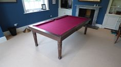 This is a 7' Modern Pool Table, in our Oak colour option 12. This table has a Hainsworth Smart Maroon cloth.  Found on our website:  www.Luxury-Pool-Tables.co.uk