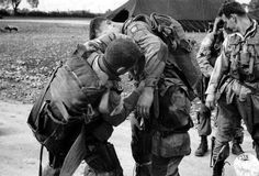 Paratroopers of the 508th PIR, 82nd Airborne Division, adjust their parachutes prior to their jump behind enemy lines near Utah Beach - 5 June 1944