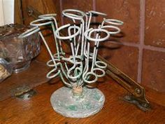vintage umbrella stand-  use bed springs